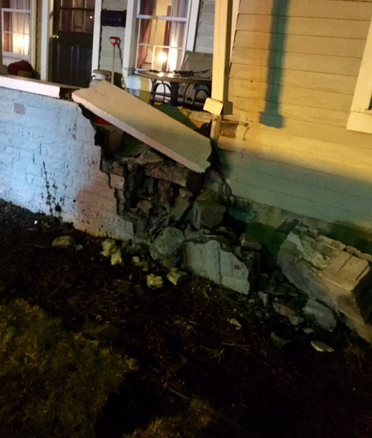 LOPD police officer crashes patrol car into porch