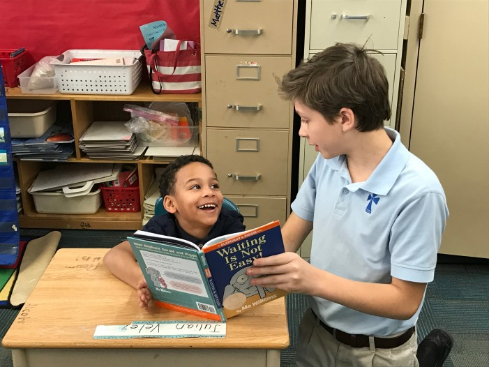 St. Joseph middle schoolers share love of books with elementary students in Pontiac