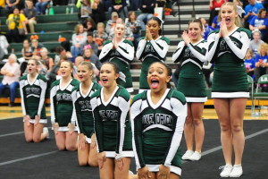 The Lady Dragons do their best to pump up the crowd during competition.Photo by Dan Shriner.
