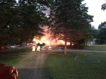 Orion Township firefighters battle a blaze at a home on Coats Road shortly after 8:30 p.m. June 26. The home exploded and then caught fire, trapping a husband and wife inside. The home collapsed, and firefighters had to dig through the rubble before recovering the bodies of the couple.