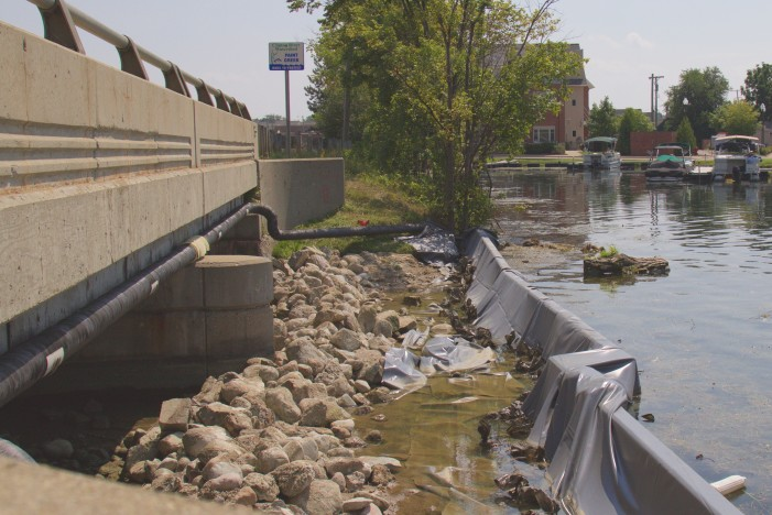 DAM, DRY  Repairs underway at Paint Creek Dam