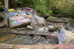 The large concrete slabs in Paint Creek, locally known as 'The Rocks' were removed this week. Orion Township officials have said that the paint on the concrete, logs and surrounding boulders were an ecological disaster.