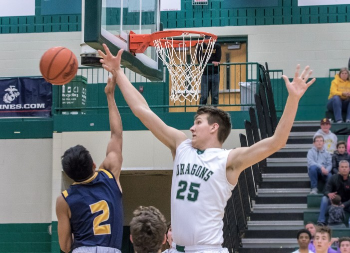 Dragons defeat Wildcats in OT, 55-54, to start the season 2-0