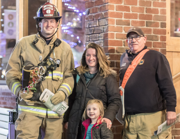 Orion Twp. Fire Dept. Goodfellows sell The Review to support area families