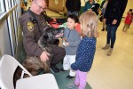 OCSO K9 Deputy Mike Garrison and Paco enjoy more than a little attention from the kids during the Orion Area Youth Assistance Family Funfest on April 18. Garrison and Paco began their retirment after the event.