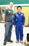 Oliver Yu, right, wearing his Space Camp uniform, talks at the Lake Orion High School Makers Fair about his camp experience, standing alongside Steve Tighe, high school science teacher. Photo by Susan Carroll.