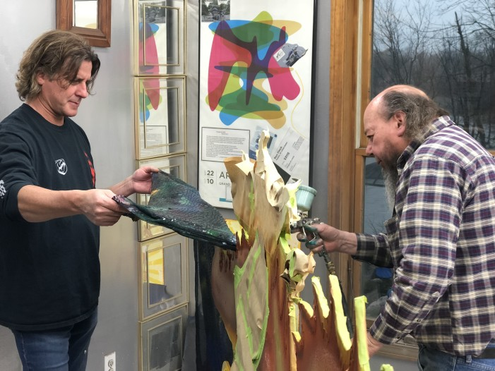 Local artists breathe new life into old Dragon sign