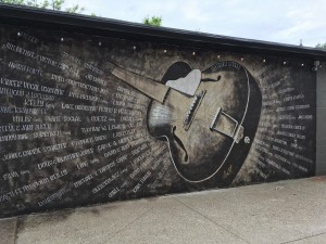 20 Front Street in downtown Lake Orion won the Game Changer award at the Oakland County Main Street awards ceremony. The music venue continues to enhance its presence. Local artist Mercea Orzo painted this guitar mural on the building's west wall, with Kelly Smith of Letters & Lattes painting the lettering.