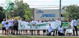 Lake Orion High School football team supporters joined the PEPP team to cheer on the football team's buses as they drove by Culver's on Thursday on their way to Ann Arbor for the season opener against Lapeer High School. PEPP is made up of parents, siblings, neighbors, friends and community members who support the Lake Orion Dragon football program.