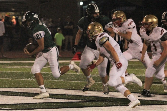 Dragons overpower Red Hawks for second win of football season