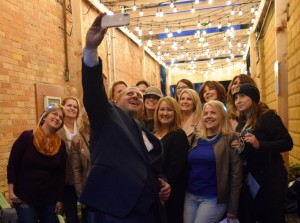 The 'Babes on Broadway' stopped in the Flint Street Alleyway for a selfie with Matt Pfeiffer, one of the Broadway Gents.