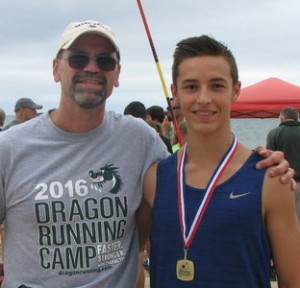 Zach Dinverno, of Lake Orion, pictured with his coach Adam Russell, won his age division at the Grand Haven Beach Vault. Photo submitted.