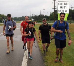 From left, Henry Kaye, U.S. Army, James Bambard, Lake Orion resident and U.S. Marine Corps., supporter Sabrina Keyes, Nick Ostrowski, U.S. Airforce, and supporter Brad Ruam were part of the group that made the 22-mile hike from Lapeer to Lake Orion during the Ruck for the Fallen march on Saturday. The march raised awareness for veterans suicide prevention. Photo by Jim Newell.