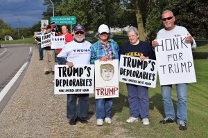 (Left to right) Orion residents Ross Ensign, Suzy Corker, JoAnn Van Tassel and Carl Cyrowski joined the flash mob rally last Tuesday supporting Donald Trump for president in the Nov. 8 general election. Local businessman Carl Cyrowski organized the flash mob through emails and word-of-mouth as a part of the grassroots effort. Photo by Jim Newell