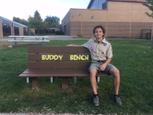Avery DePauw sits on one of three Buddy Benches he constructed at Carpenter Elementary. Photo provided.