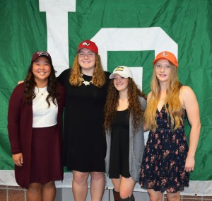 Lake Orion High School student-athletes (from left) Moyea Russel, Shelby Misiak, Jamie Bell and Sarah Hennings all signed national letters of intent on Nov. 9 to continue their playing careers in college. Photo by Jim Newell.