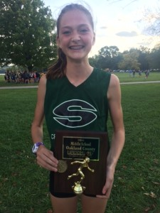 Above, Novak with her Oakland County Middle School trophy. Photo provided.