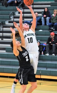 Sophomore Maddie Novak, No. 10, shoots the ball for a basket in Lake Orion's win over Troy High School. Photo by Jim Newell
