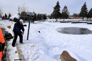 Tim Williams chips to the 'green' during a round  of ice golf on Lake Orion. They do this for fun?