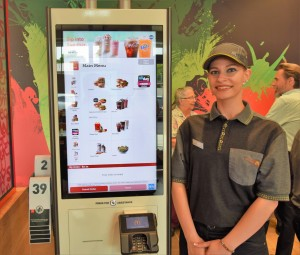 The new McDonald's features four touch screen ordering kiosks.