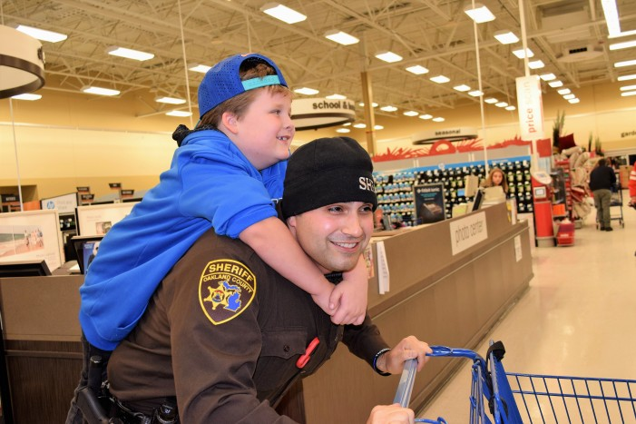 Orion first responders connect with kids during Shop with a Hero