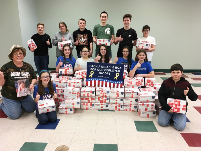 Area students pack Miracle Boxes to send to troops overseas