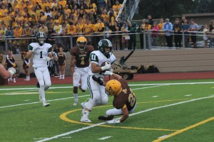 Junior Mitch Howell breaks a tackle on his way to the end zone in the first half.