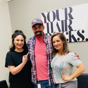 Garrett Hoffman got his beard dyed pink Wednesday at the Fringe Salon in Lake Orion. Owner Lauren Knapp (right) is Hoffman's longtime friend and Jordan Rymer (left) actually colored his beard. Photo provided.