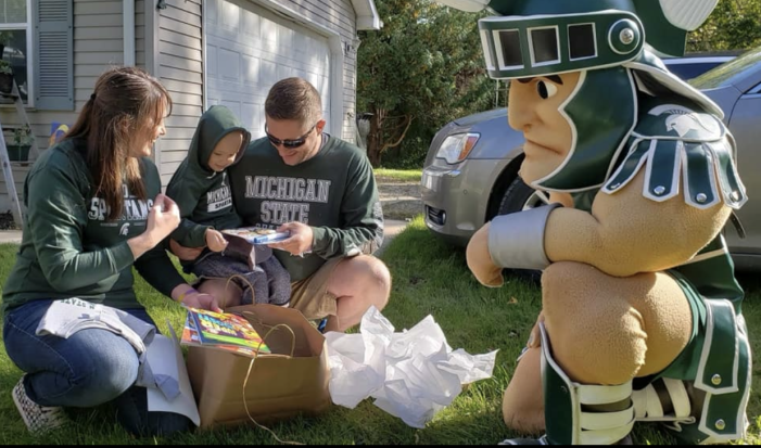 Little Spartan fan Pryce Redmond gets a big visit from Sparty and cheer team after cancer diagnosis