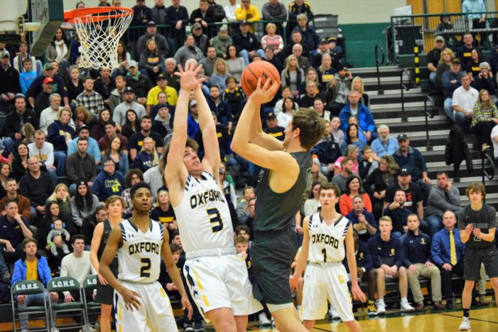 Lake Orion falls to Oxford in district championship basketball game