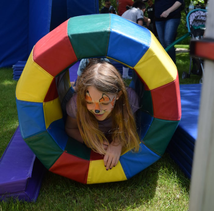 Orion reads — and plays — at the library's Summer Reading Kickoff party