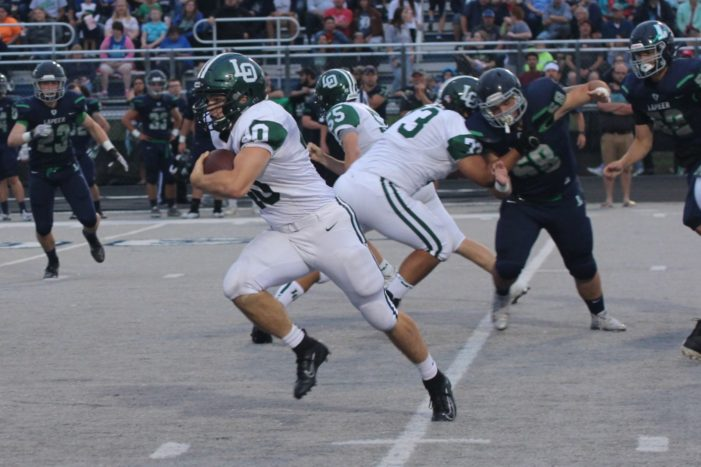 Dragons douse Lightning for opening football victory