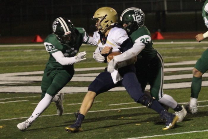Dragons hold off pesky Cougars in opening round of football playoffs