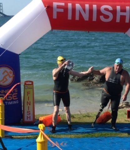 LOHS alumni becomes first amputee to complete Mighty Mac Swim