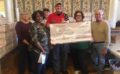 VFW Post 334 donates $1,000 to Women Marines Assoc. to support Christmas boxes for troops overseas