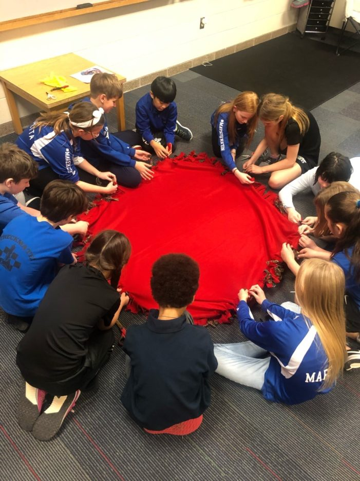 St. Joe's students make blankets for Fleece & Thank You