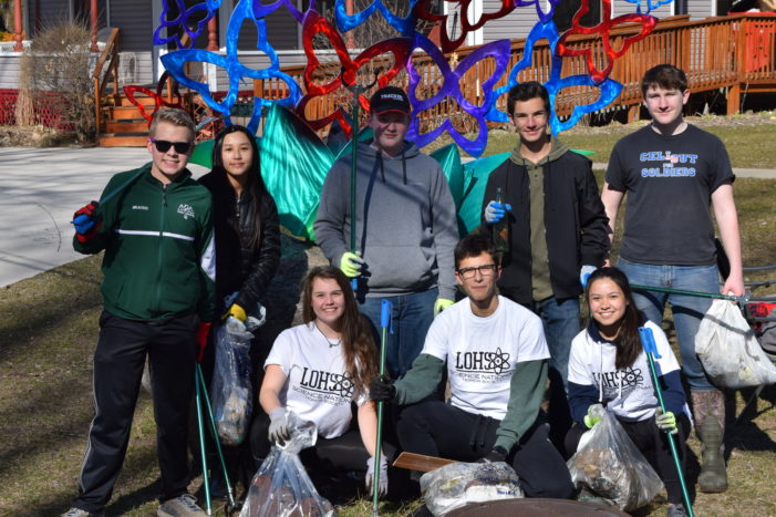 Lake Orion High School science students clean up along Paint Creek
