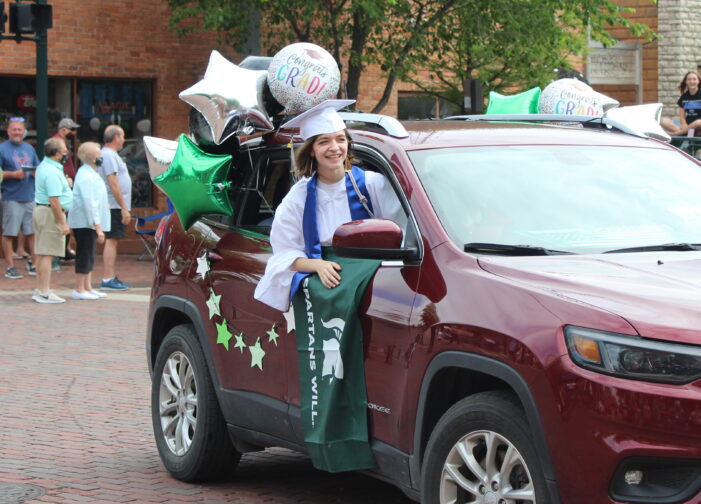Dragon graduates cruise through downtown LO