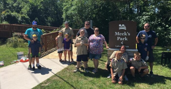 Cub Scout Pack 233 give a little TLC to Meeks Park bridge