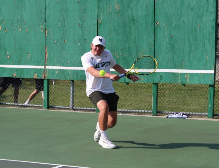 Dragons tennis returns for shortened season, falls to Rochester Falcons