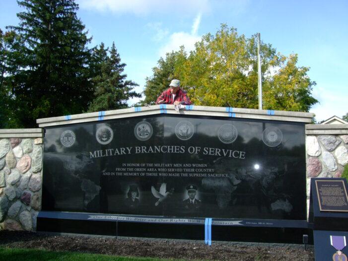 Volunteers fix up Veterans Memorial walls