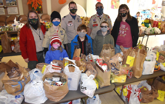 Pack 128 scouts collect, deliver 3,500 pounds of food to help Oxford/Orion area families