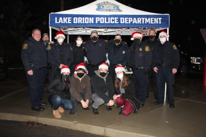 The Lake Orion Police Association modifies, but host its annual Shop with a Hero