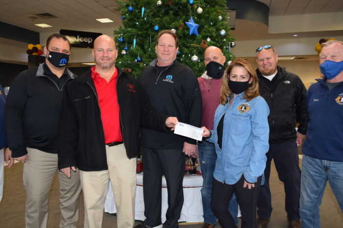 Milosch family supports the Lake Orion Lions Club Christmas Basket program with $5k donation