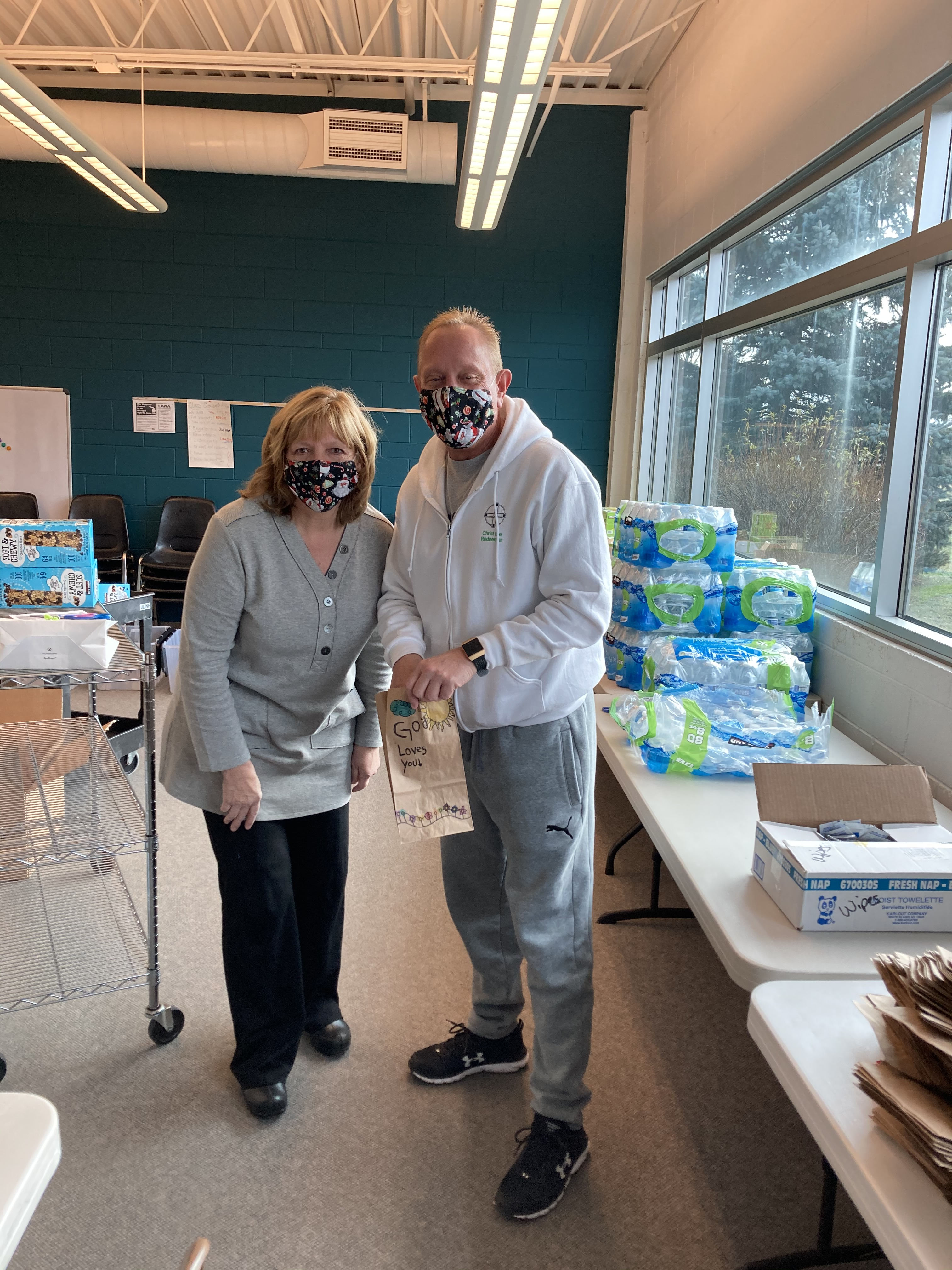 Lisa Pratt & Fr. Bill Promesso putting together snack packs.