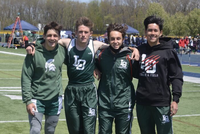 Dragon boys, girls track & field dominant in win over Clarkston