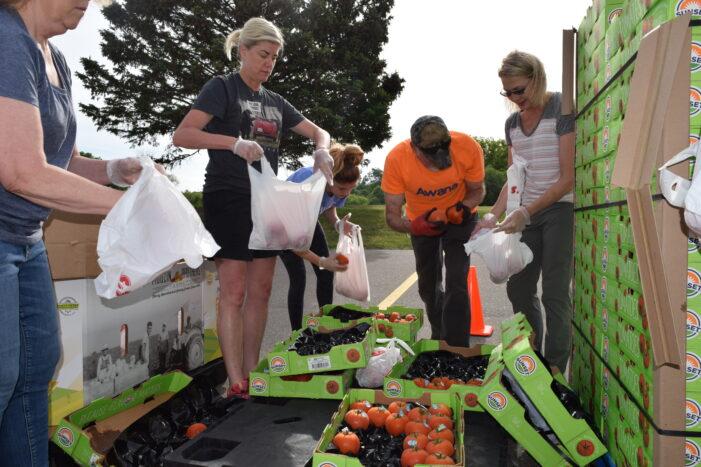 Forgotten Harvest volunteers in Orion Twp. distribute food to neighbors