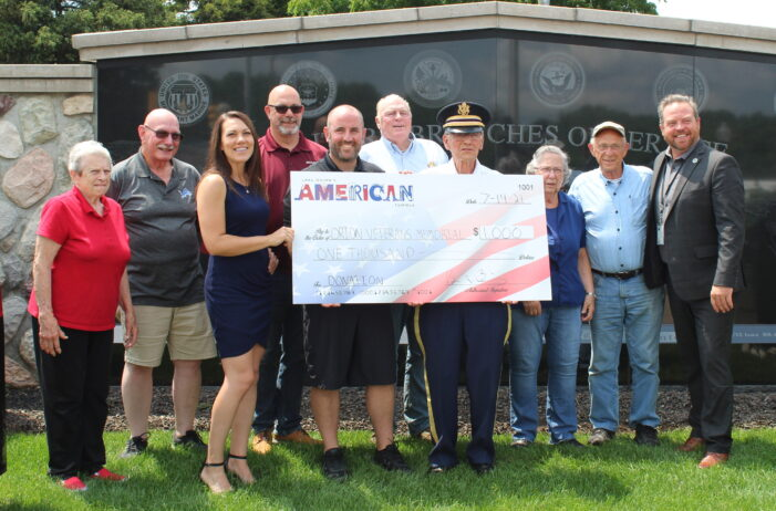 Lake Orion's American Summer donates $1,000 to the Orion Veterans Memorial board